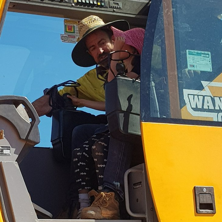 Chloe showing Russel how to drive the crane