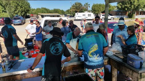 The Mahi crew filleting the catch